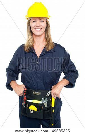 Confident Female Worker In Yellow Helmet