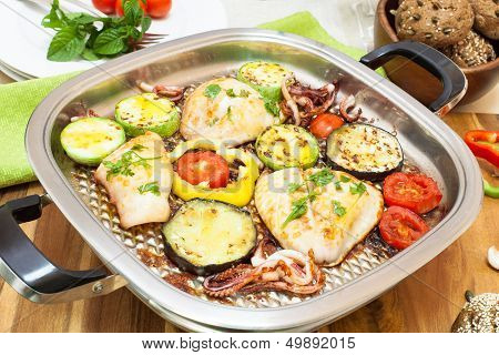 Grilled squids and vegetables on grill pan