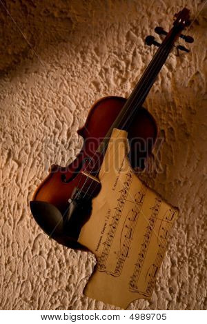 Old Violin With Burnt Music Sheet