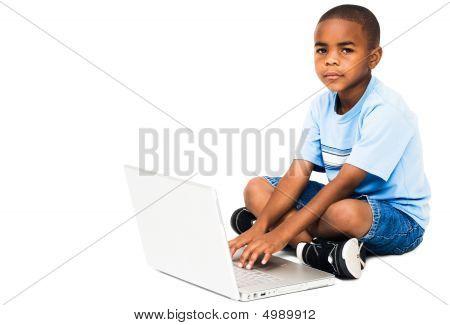 Portrait Of Boy Working On Laptop