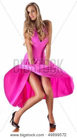 Young woman in a magenta dress