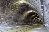 stock photo of tunnel  - Tunnel in a night with railroad lines - JPG