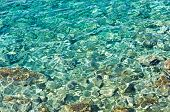 stock photo of crystal clear  - Rocky sea floor visible thru crystal clear turqoise water of Aegean sea in Greece - JPG