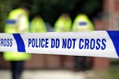 stock photo of crime scene  - Crime scene investigation police do not cross boundary tape investigating police team - JPG
