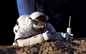 foto of creeping  - Astronaut crawling on the planet - JPG
