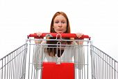 image of pity  - A sad shopping woman hanging behind her empty shopping cart - JPG