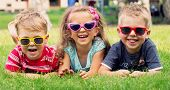 stock photo of playground school  - Smiling kids at the garden - JPG
