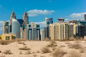 Midday Heat In The Desert In The Background Buildingsl On Nov 17, 2012 In Dubai Uae