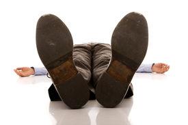 image of peg-leg  - businessman feet of a dead body  - JPG