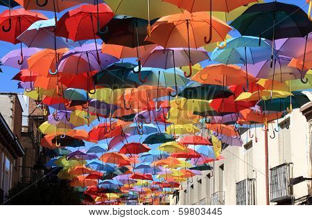 Street decorated with colored umbrellas.Madrid, Spain