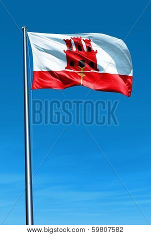 Gibraltar flag waving on the wind