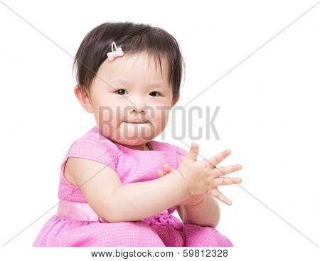 Asia baby girl clapping hand