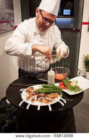 Cook Preparing Finger Food At Bit 2014, International Tourism Exchange In Milan, Italy