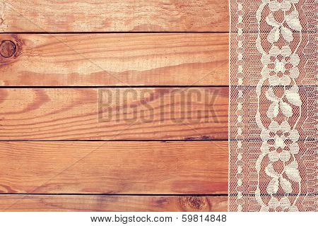 Beautiful White Lace With Floral Ornament On Wooden Boards
