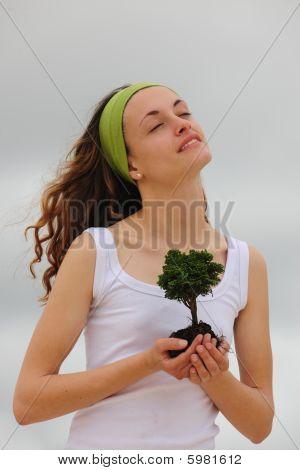 Spiritual Woman Planting A Tree