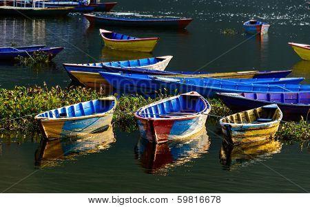 Colorful barques on Fewa Lake in Pokhara, Nepal