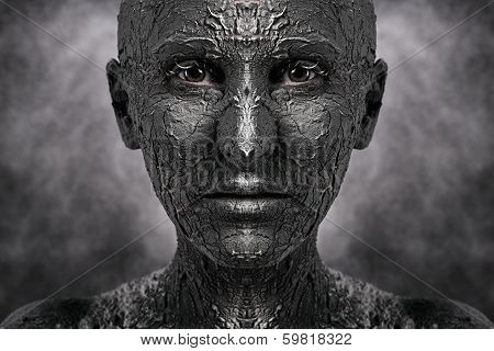 Symmetrical terrible face with cracked skin