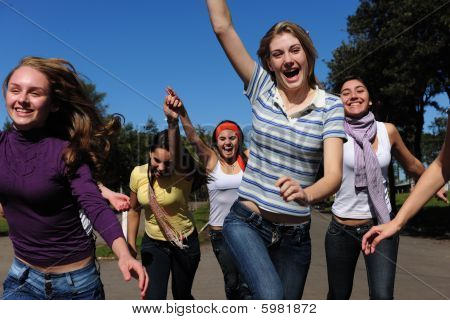 Crowd Of Crazy And Happy Teen Girls Running