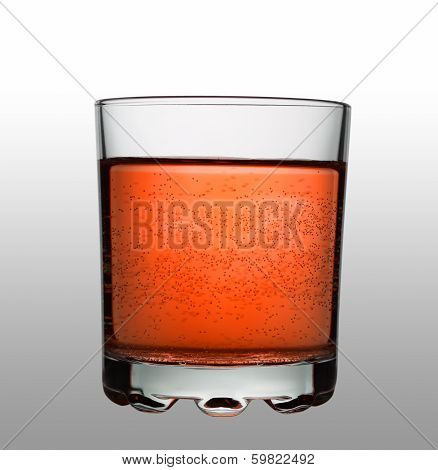 Glass With Red Fizzy Cocktail On Gradient Background