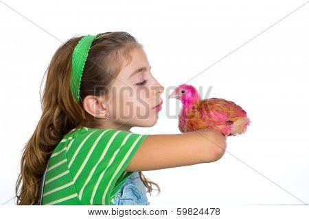 breeder hens kid girl rancher farmer kissing a chicken chick white background