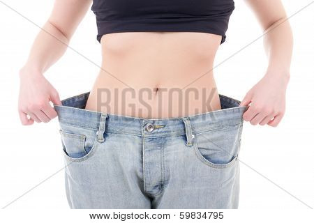 Weight-loss Concept - Slim Woman In Big Jeans Isolated On White