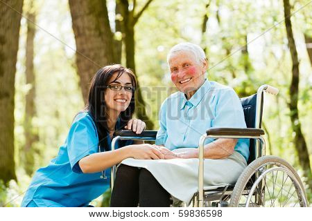 Smiling Doctor With Kind Woman