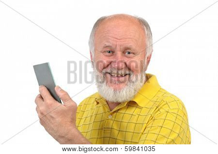 smiling senior bald man with mirror and bad teeth