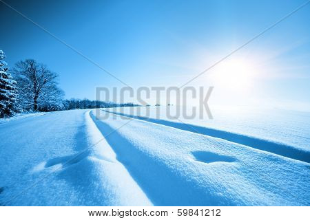 snowfield and the sun on the horizon