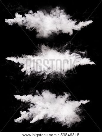 Freeze motions of white dust explosions isolated on black background
