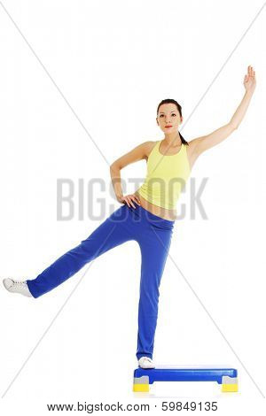 Fitness girl is working out with stepper , isolated on white background