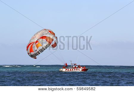 Parasailing in a blue sky in Punta Cana, Dominican Republic