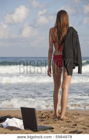 Woman With Jacket On The Beach