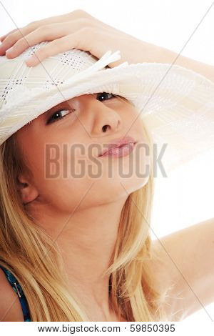 Young summer girl in hat, isolated onw hite