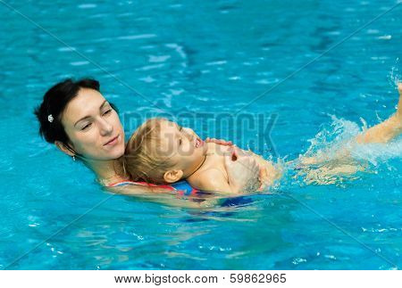 Mother Teaching Baby Boy To Swim