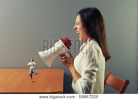 hysterical woman screaming at small meditation calm woman