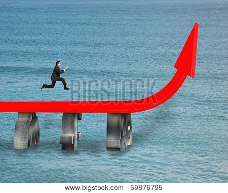 Businessman Running On Growing Red Arrow