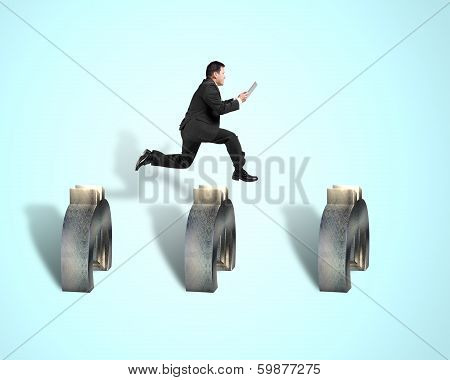 Businessman Jumping Over 3D Euro Symbols