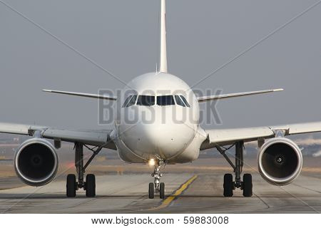 Taxiing White Plane