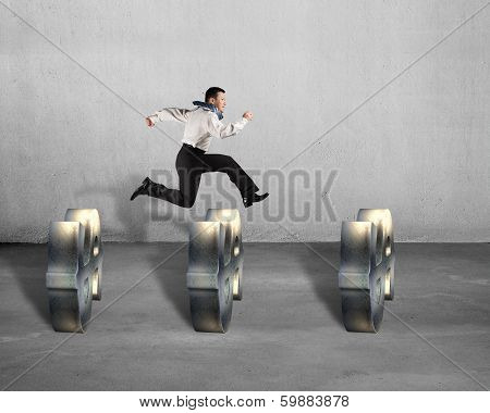 Businessman Jumping Over Usd Symbols