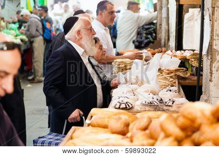 Jerusalem, Israel - November 15, 2012: People are shopping at Mahane Yehuda - famous market in Jerusalem