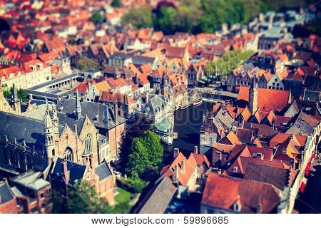 Aerial view of Bruges (Brugge) from Belfry, Belgium. Tilf shift effect. Cross processed vintage retro style.