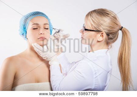 Beautician with patient doing botox injection
