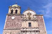 stock photo of pilaster  - Church facade with columns arches and bell tower in Tequila Mexico - JPG