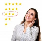 stock photo of average looking  - Woman looking up and choosing average stars rating - JPG