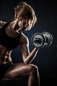 image of elbows  - Brutal athletic woman pumping up muscules with dumbbells - JPG