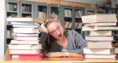 foto of midterm  - Teenager girl studying for her midterm in a library - JPG