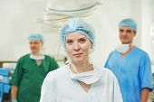 picture of obstetric  - Team of surgeon in uniform after surgery operation at clinic operating room - JPG
