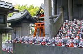stock photo of inari  - Little fox statues at Fushimi Inari Shrine in Kyoto Japan - JPG