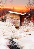 stock photo of water-mill  - Old frozen water mill near icy water Christmas scenery - JPG