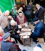 Jerusalem, Israel - November 15, 2012: Men play backgammon game in a back alley of Mahane Yehuda, fa